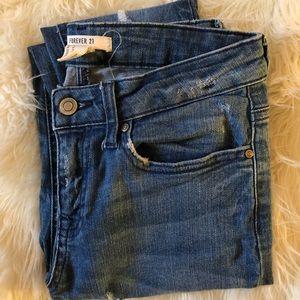 slightly distressed skinny jeans